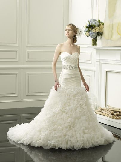 D8055  Rich silk stretch satin is pleated into a strapless, sweetheart bodice, with a soft and airy...