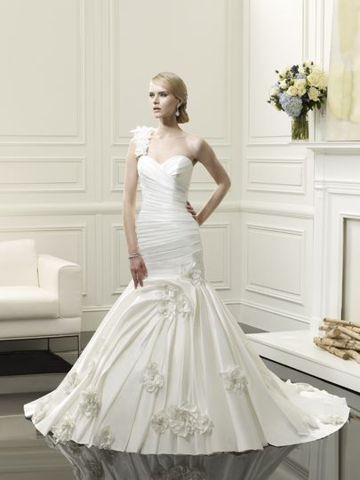 D8056  This fit and flare features a flattering sweetheart neckline and a ruched bodice that flaunts...