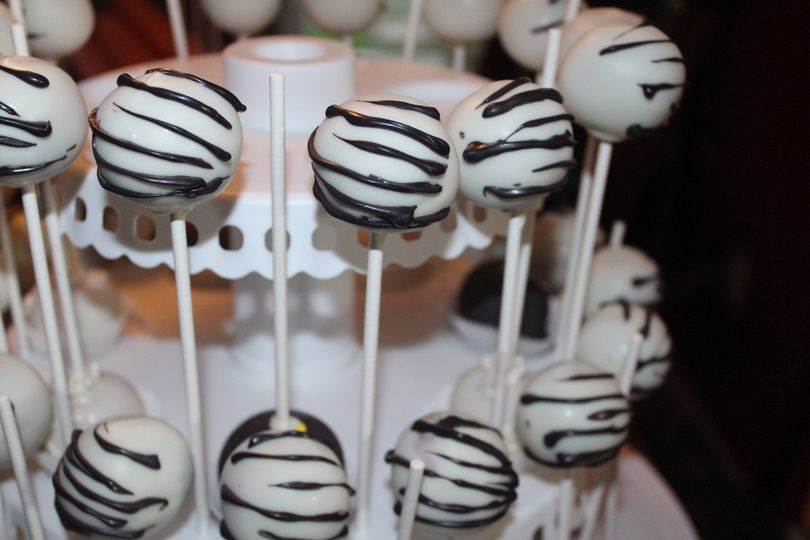 Ooey Gooey's designers can match your theme and style.  Zebra Cake Pops for your wedding dessert...