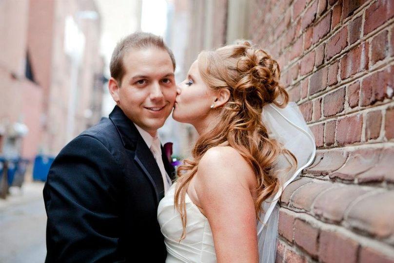 Bride kisses groom on the cheek