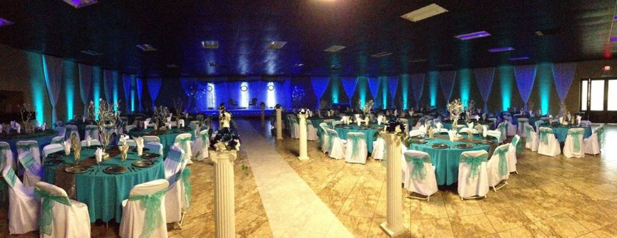 Teal up-lighting with runner in main banquet room