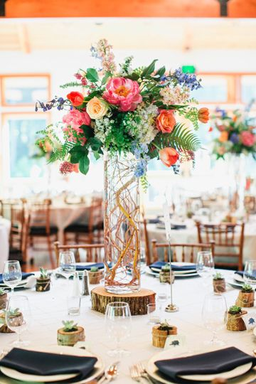 Tall centerpieces on wood rounds
