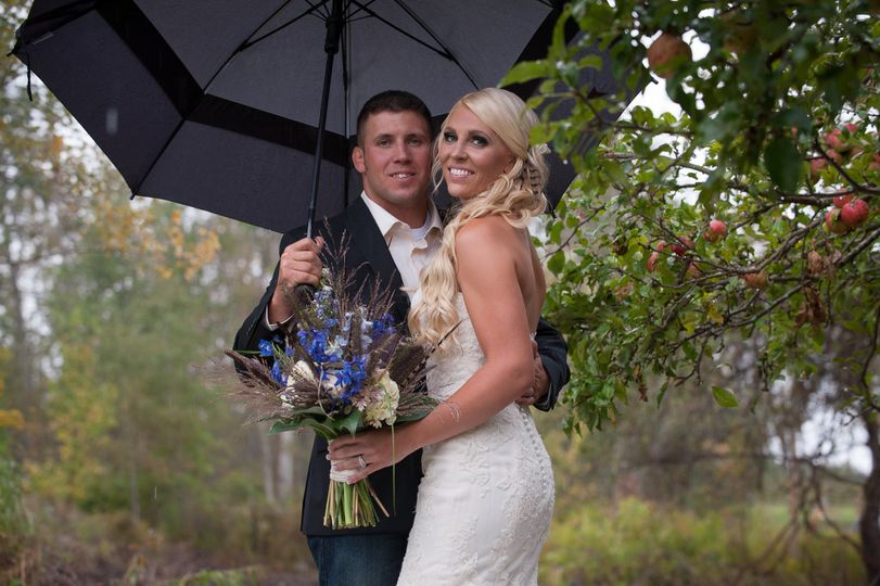 """It poured on our wedding day. There was only a small opportunity for outdoor pics, and he made it..."
