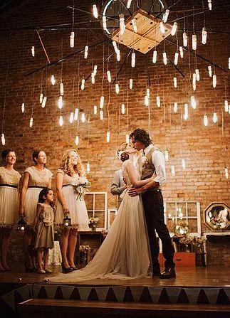 Newlyweds dance under the lights