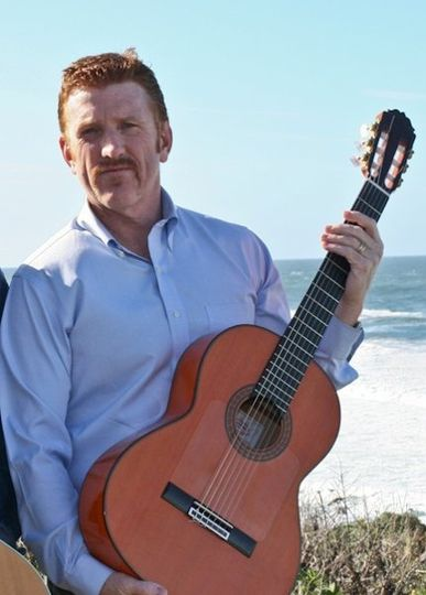 Mike McCall, Spanish Guitarist before a wedding at Montara Beach
