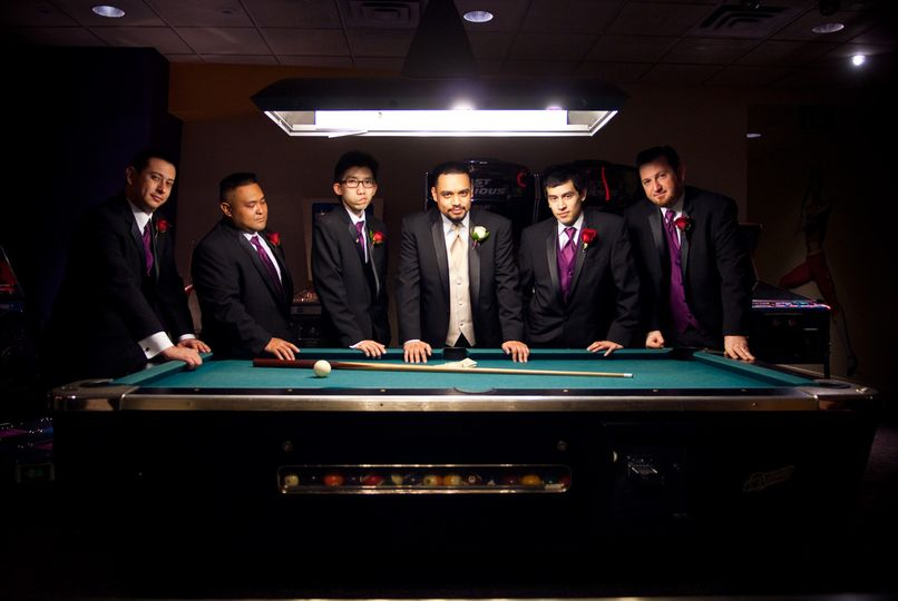 Gather the groomsmen in the arcade for a serious yet fun photo!
