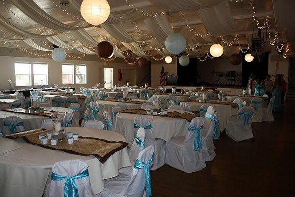 Customer Wedding with our rental banquet chair covers and satin turquoise sashes.