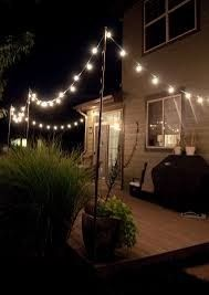 Globe lighting on a patio with support poles