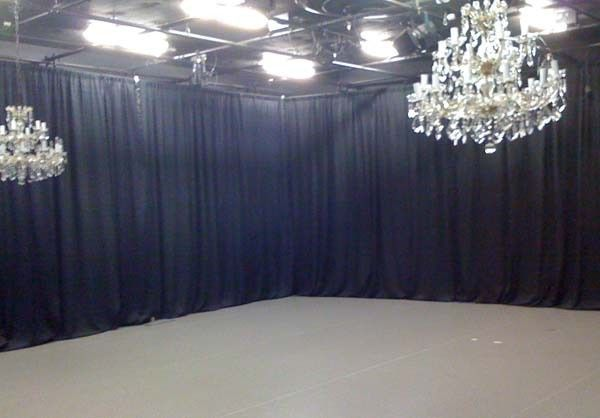 Black sheer backdrop with chandelier