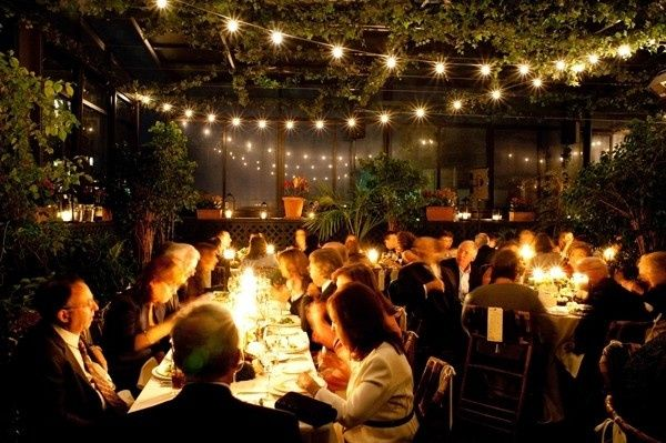 Criss-cross globe lighting in outdoor venue