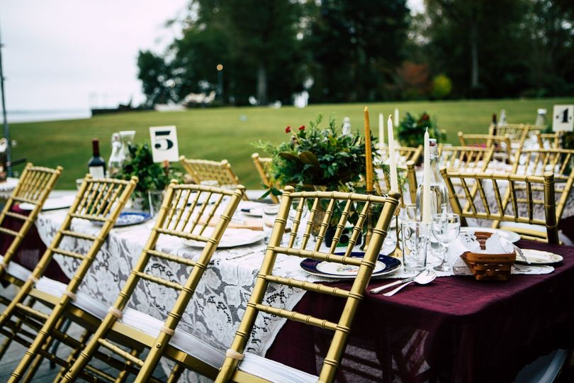 Vintage romance reception in New Bern, NC. Chivari chairs, gold  & lace. Photo by Justin Driscoll.