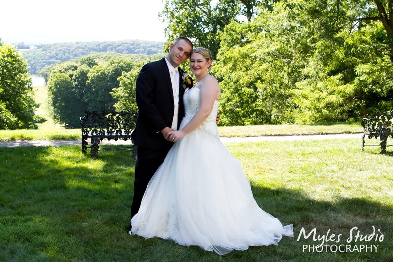 A portrait of the bride and groom taken on the grounds of Locust Grove in Poughkeepsie NY, along the...