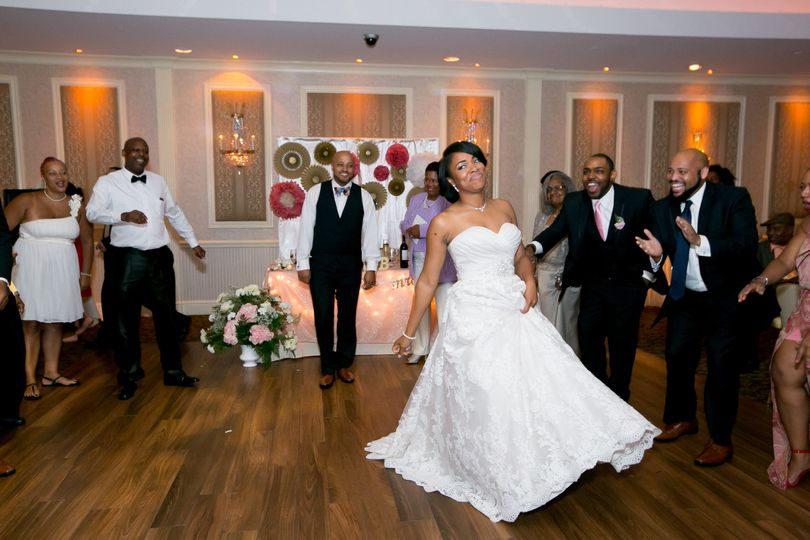 Photo of the bride dancing with the groom during their reception at the Poughkeepsie Grand Hotel in...