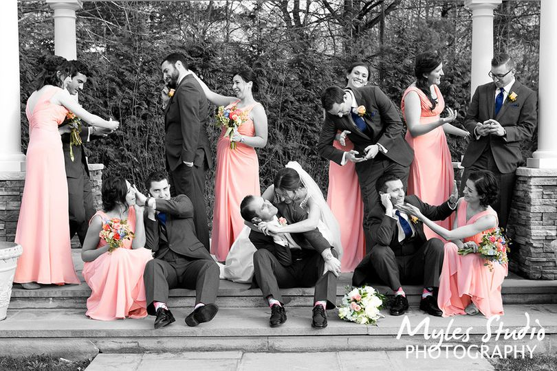 A black and White image mixed with color, to produce this amazing photo of a wedding party taken at...