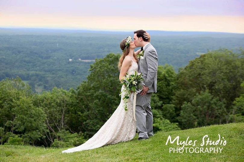 A intimate embrace by a bride and groom, as they posed for photos at their wedding, taken at The...