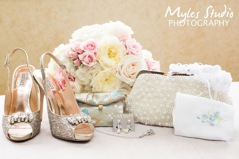 This is a illustrative photo using various items of the bride, including her bouquet , shoes,...