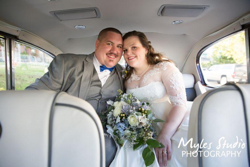 Bridal Couple in their car.