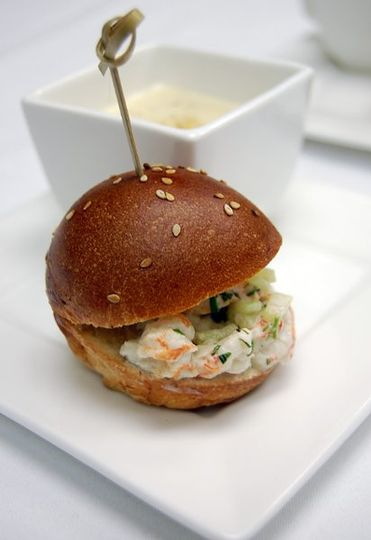 New England Duo: housemade creamy clam chowder and petite langoustine salad on brioche