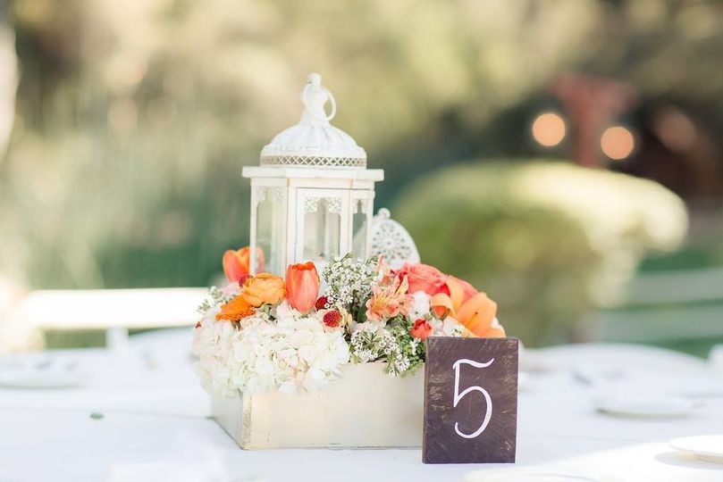 White table centerpiece with a touch of orange