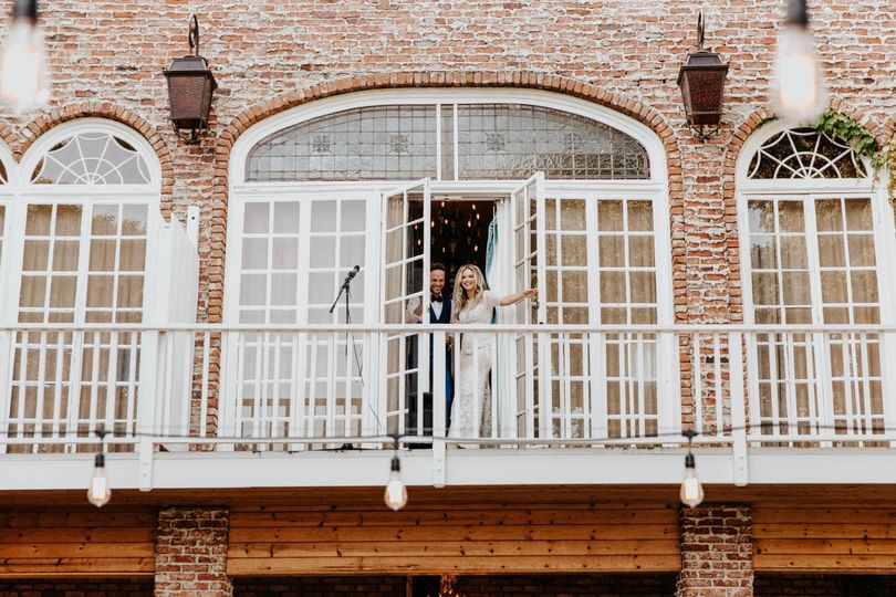 Bride & Groom on balcony