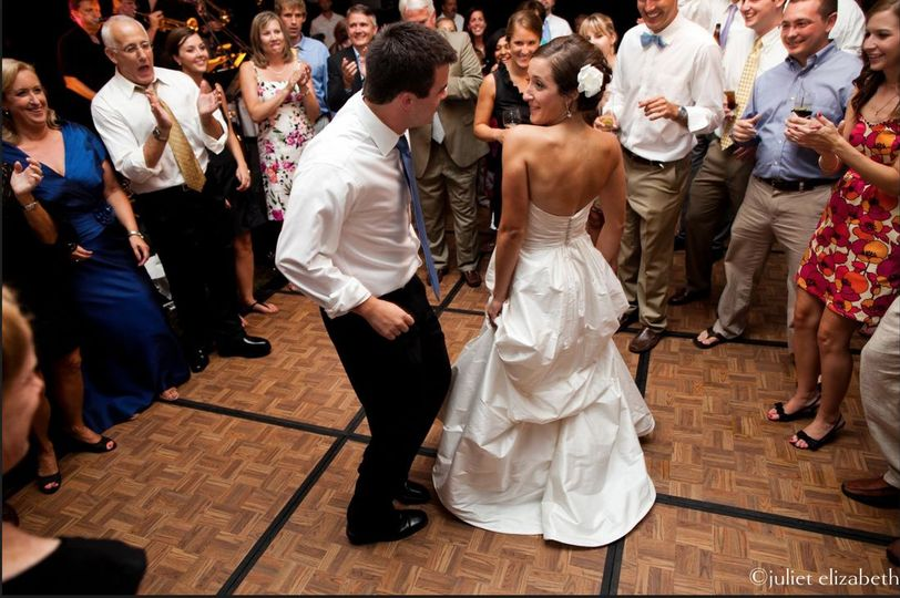A lovely newlywed couple takes the floor for their 1st dance