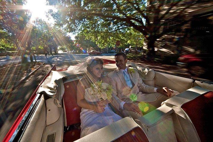 Couple in their wedding car