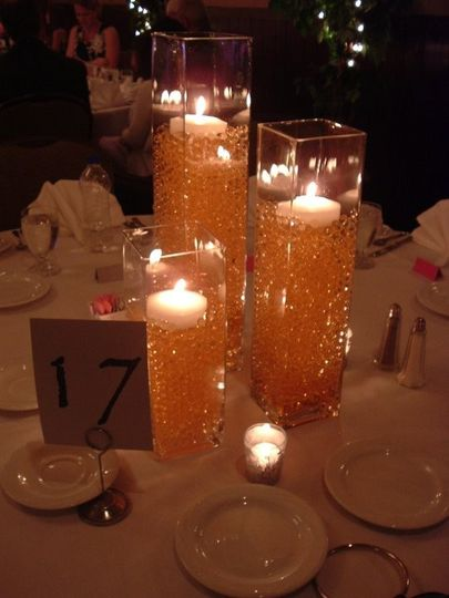 Dining table setting with candles in a vase