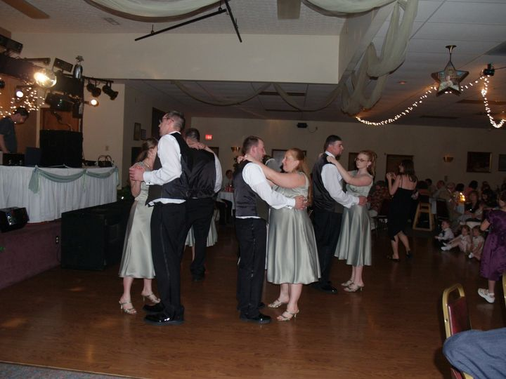 Dancing bridesmaids and groomsmen