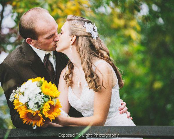Bride and Groom kiss on bridge in Minneapolis, Minnesota.