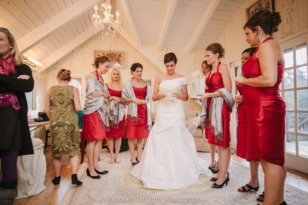 Bride reading Groom's letter to her at Woods Chapel in Orono Minnesota.