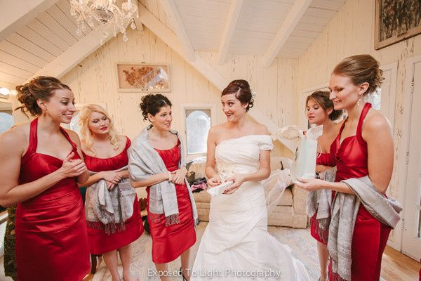 Bride with bridesmaids prior to wedding ceremony at Woods Chapel in Orono Minnesota.
