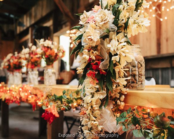 Head table with flower bouquets. Weddings in Echo Valley. Clear Lake, Wisconsin.