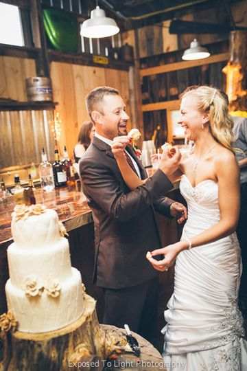 Wedding couple sharing the wedding cake at Weddings in Echo Valley. Clear Lake, Wisconsin.