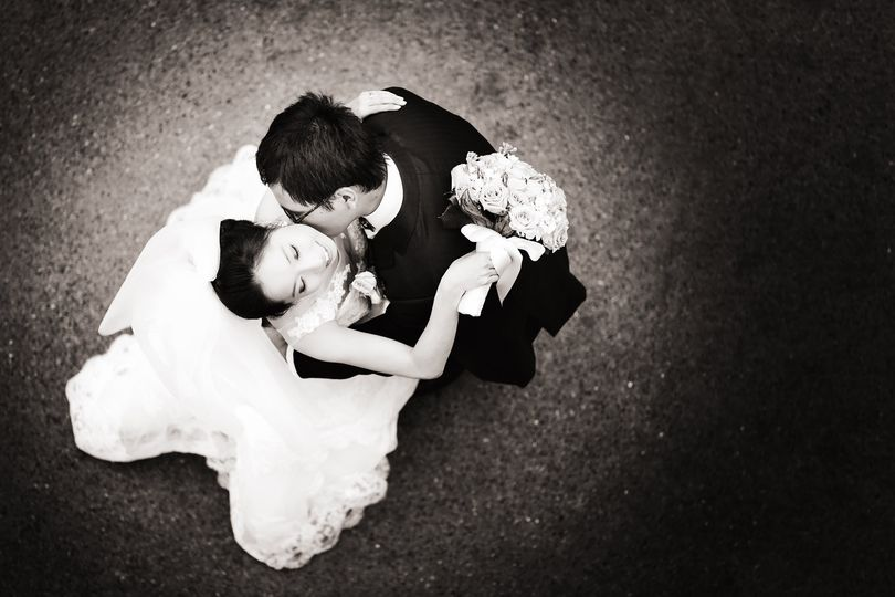 Wedding couple embrace photographed from above in Minneapolis, Minnesota.