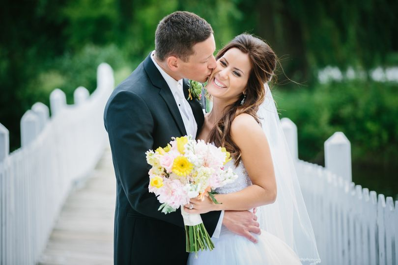 Bride and Groom photo after ceremony at Majestic Oaks Golf Club in Minneapolis, Minnesota.