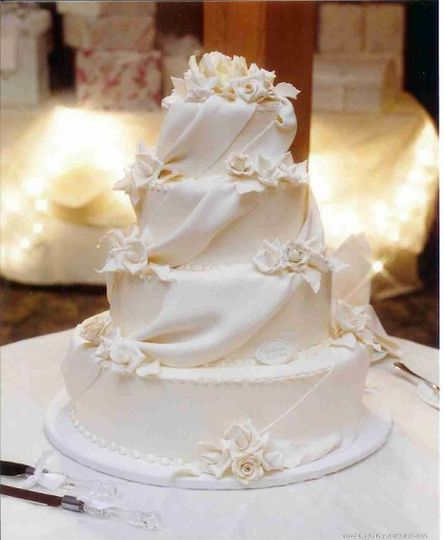 Sugar roses drapes and leaves in ivory