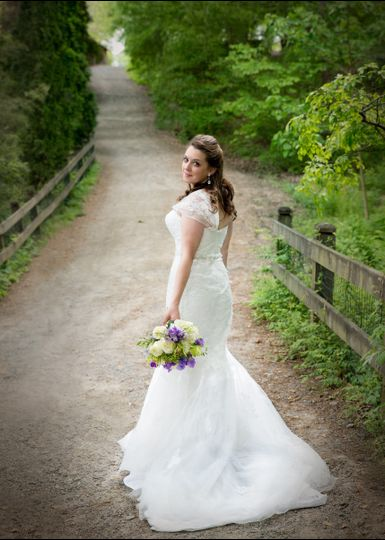 bride poses at unc botanical gardens in charlotte