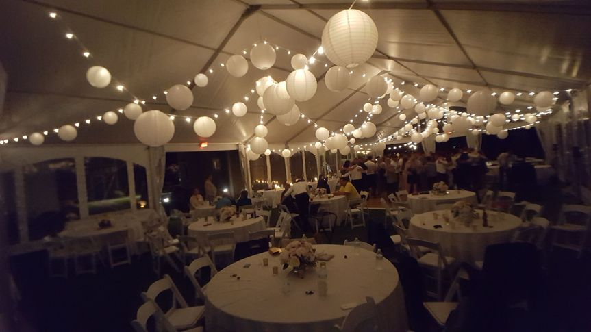 String lighting and white paper lanterns at the Lake House Guest Cottages of the Berkshires.