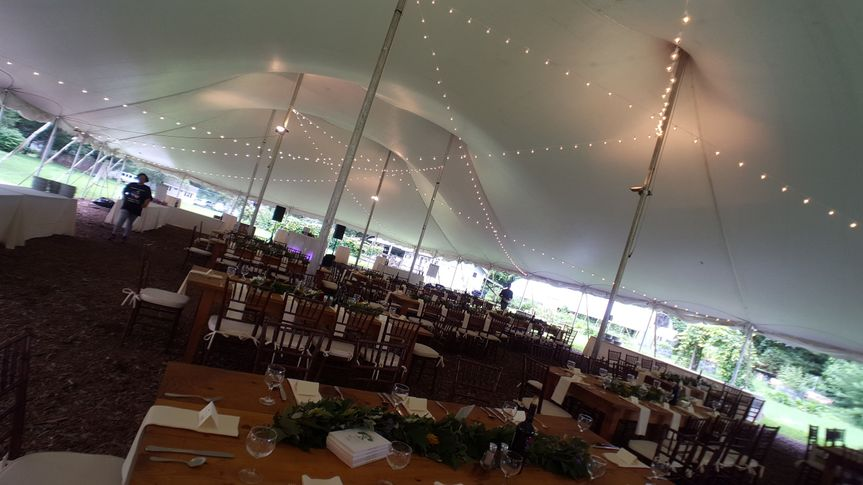 "String lighting in a 60"" by 110"" tent at this wedding at the Isabella Freedman Jewish Retreat..."
