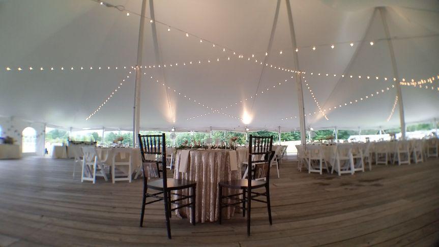 String lighting under this 60' x 100' tent at Hancock Shaker Village.