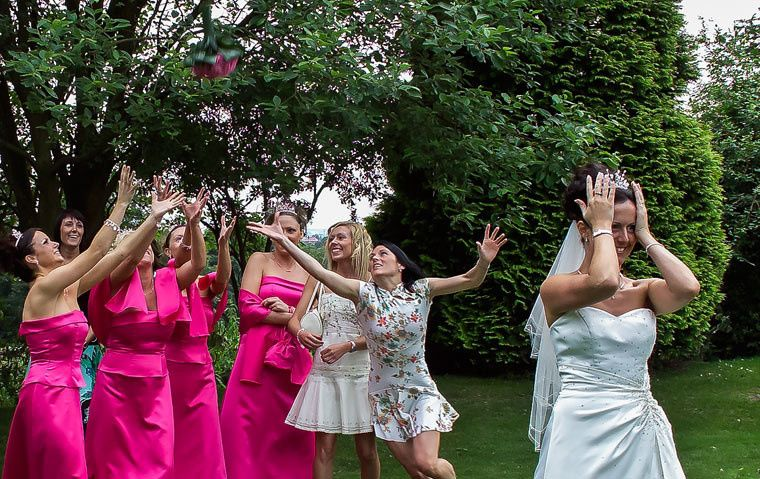 Bride throwing have Bouquet