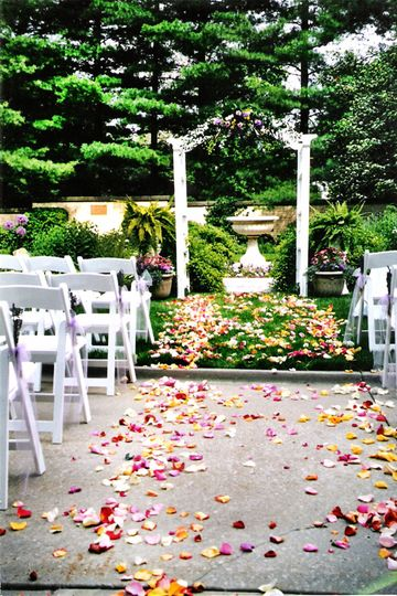 Wedding Consultant, padded white chairs, archway, set up and tear down all provided.