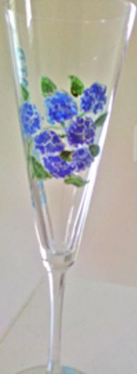 Hand painted bridesmaid glasses customized for your special day. We hand paint any design with names...