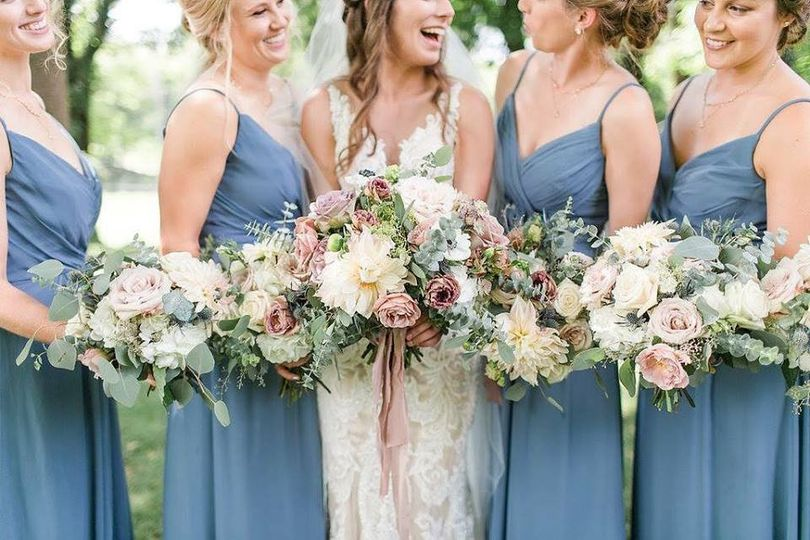 The bride and bridesmaids holding their bouquet