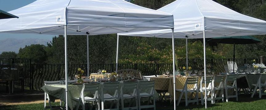 Outdoor table setup with tent