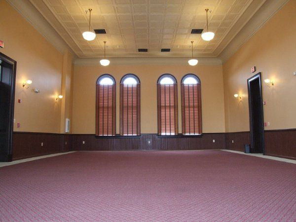 Gorgeous ballroom boasts high pressed-tin ceiling, wainscotting and beautiful color combination....
