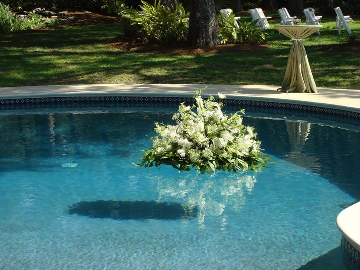 Pool float of all white flowers.