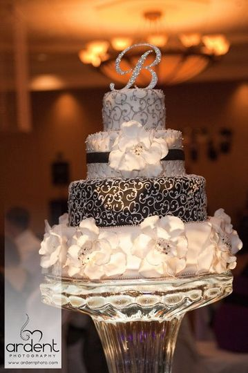 Black and white wedding cake with fun oversized floral by Tamara's the Cake Guru Wisconsin