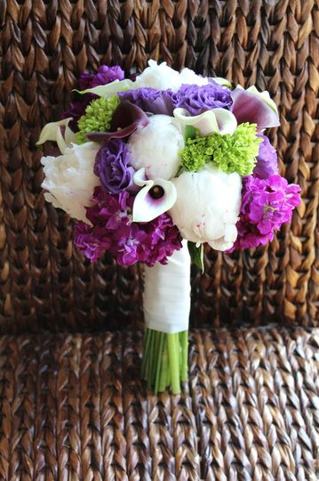 Purple, white and green bouquet of peonies, hydrangea, calla lilies, stock, and lisianthus