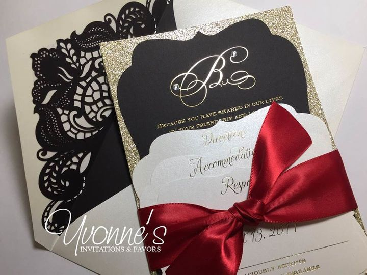 Black and gold invite with a red ribbon